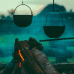 Tikkho Maciel Photo of iron cooking pots over campfire