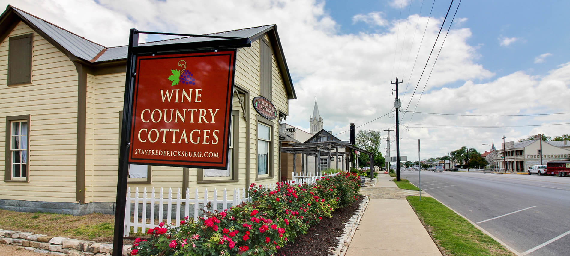 wine colored wine country cottages sight with view of cabin and main street