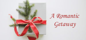 white gift box with evergreen sprig and red ribbon bow text: A Romantic Getaway